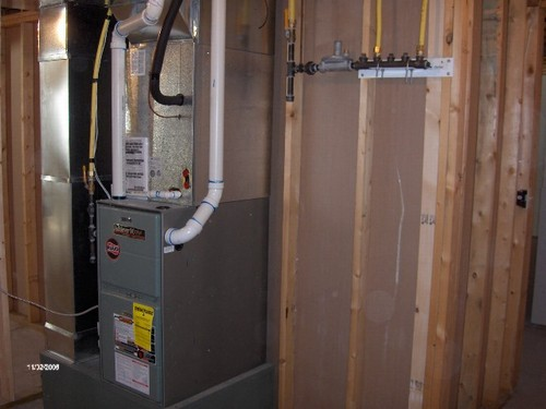 basement forced air furnace and central air also extra gas hook ups