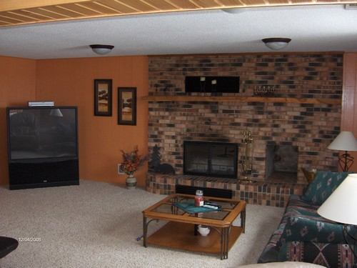 basement fireplace. made of nice brick.  also shows new carpet.