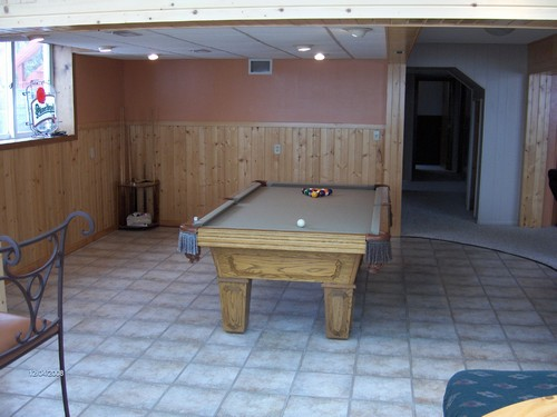 pool table room beautiful addition to the lower level.  very open floor plan.