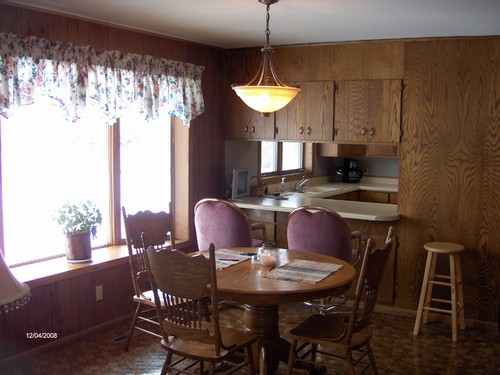 dining room shows opening to the kitchen.  located right off of living room.
