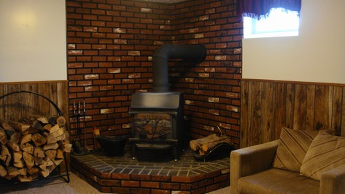 family room wood burning stove and brick foundation.