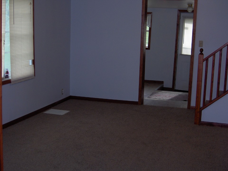 living room new carpet.  front entry with main floor laundry.