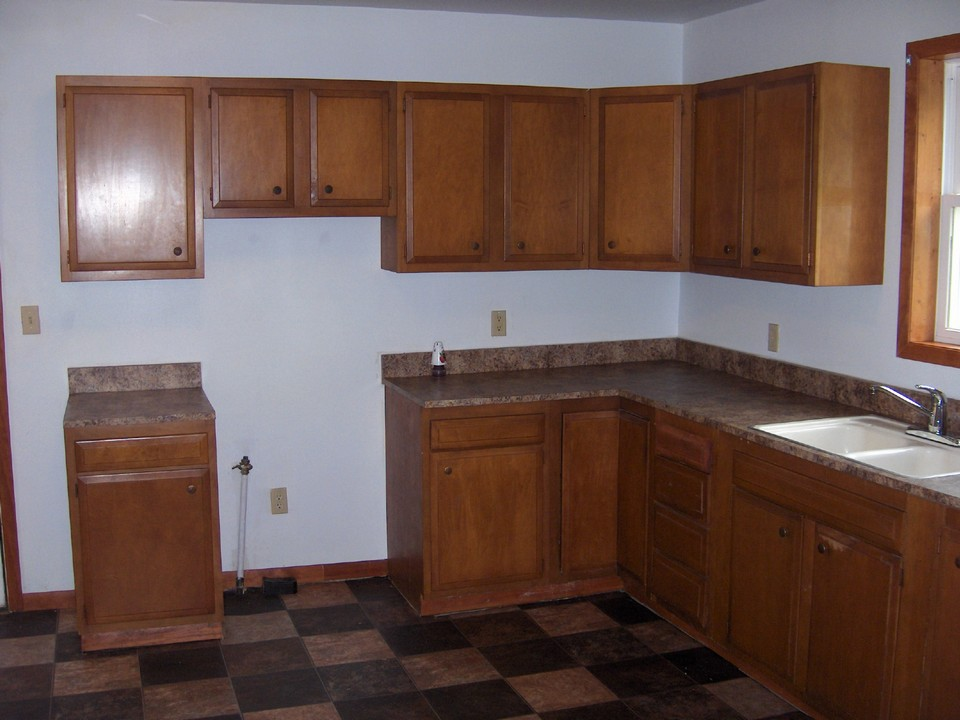kitchen lots of cupboards and new flooring.