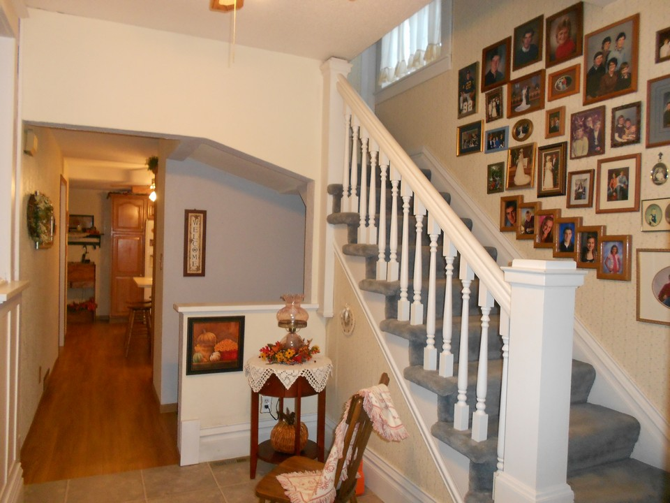 open stairway and entrance to the kitchen