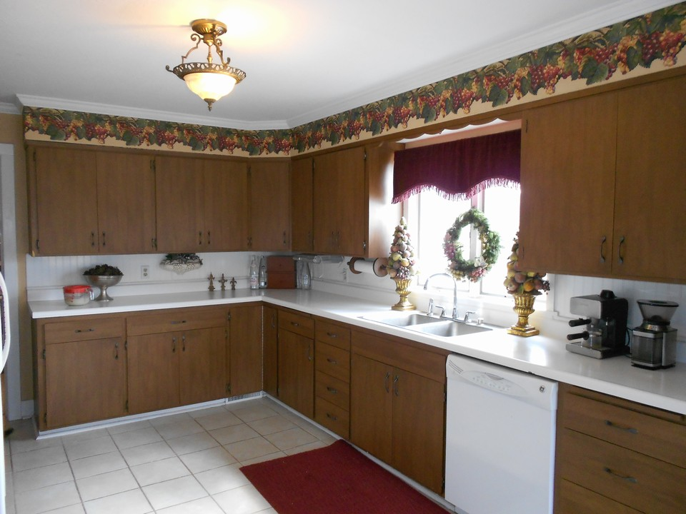 kitchen tile floor, crown molding, dishwasher, lots of cupboards