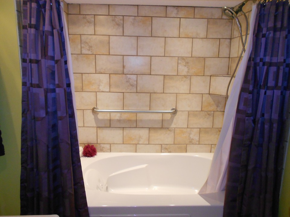 basment bathroom jacuzzi tub and tiled shower