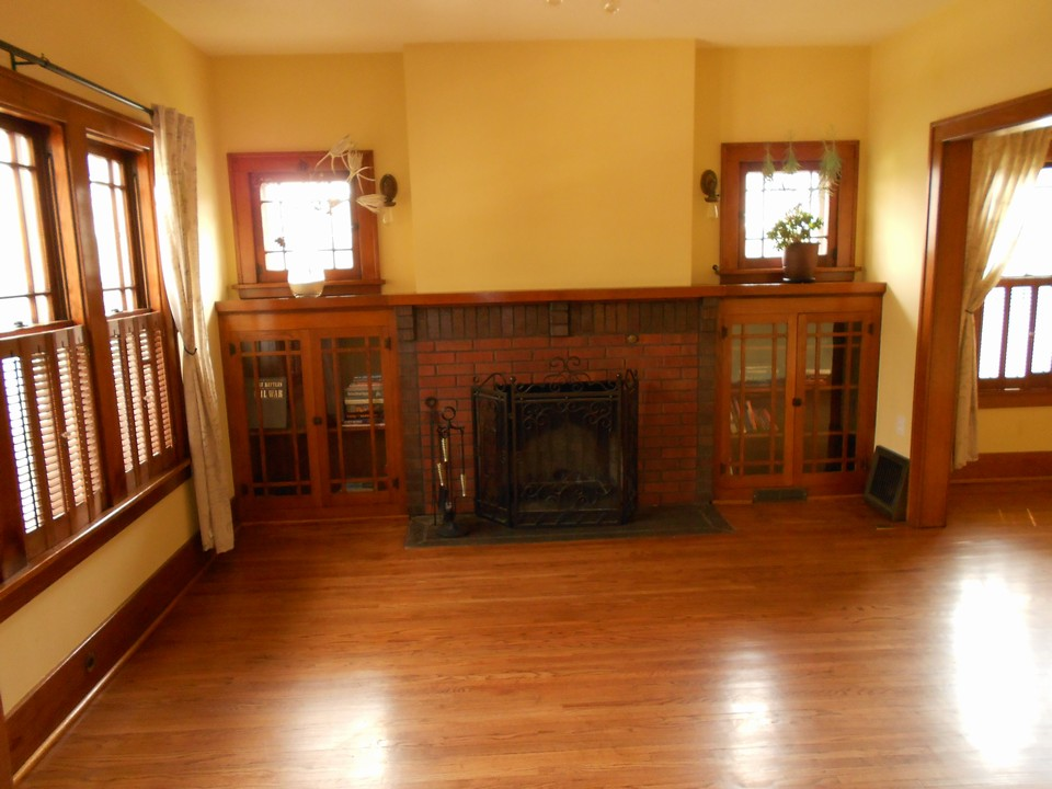 living room and fireplace character windows and built in display case