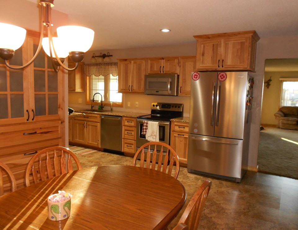 dining room, kitchen, living room built in storage, stainless appliances, cambria countertops, hickory easy close cabinets