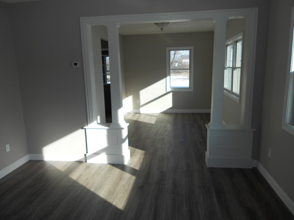 living and dining rooms solid wood trim.  new paint.  pergo laminate floors.  very open plan.