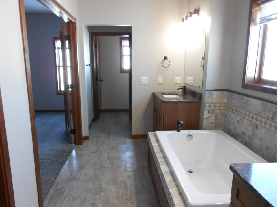 master bathroom tiled jacuzzi and walk in shower.  dual sinks.