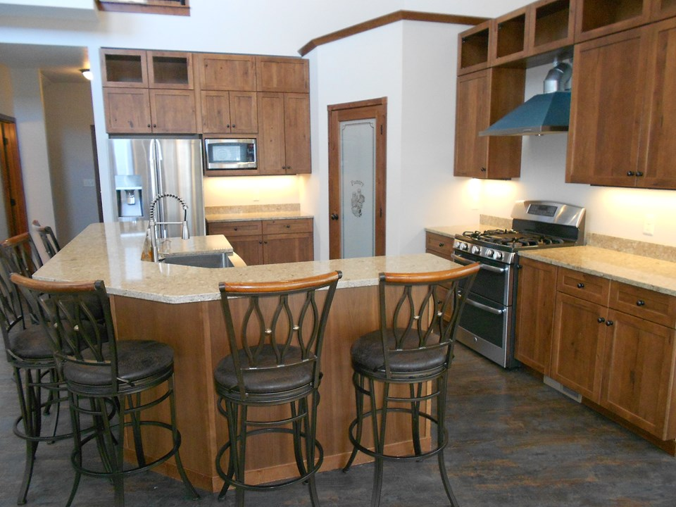 kitchen cambria. gas stove/grill.  double drawer dishwasher.  stainless farmer's sink.