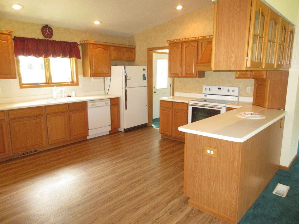 kitchen very spacious, new stove, new garbage disposal, new flooring
