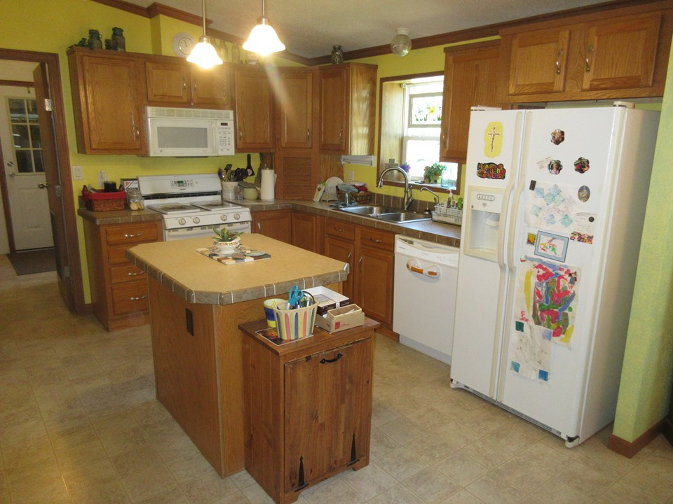 kitchen with island appliances are staying.