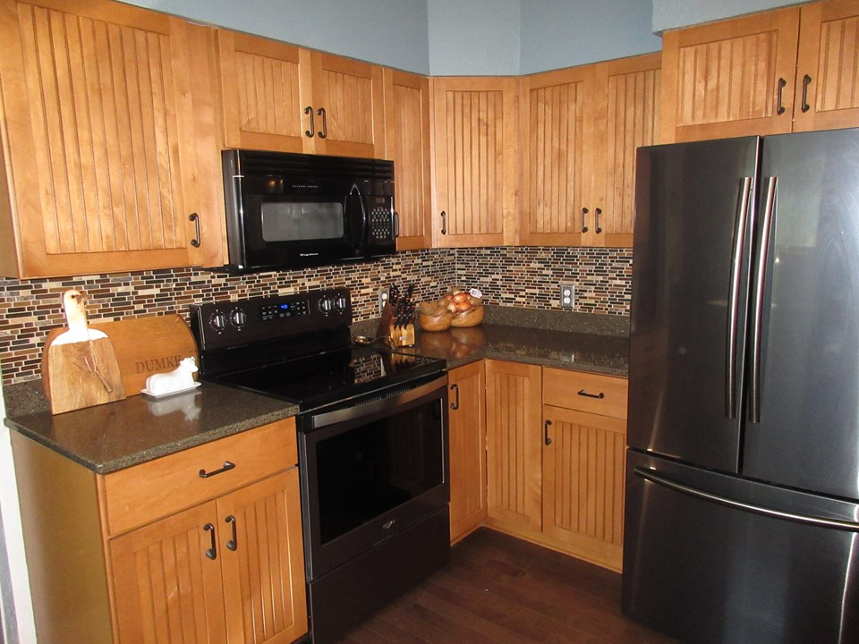 kitchen granite countertops, black stainless steel appliances