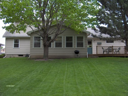 back huge lot with plenty of room.  nice trees.  deck with entry to house and garage.