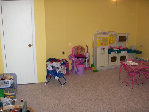 basement play room that is private.  other than an egress window, this would make a great bedroom.