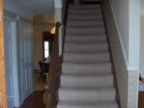 entry area. open stairway to the bedrooms upstairs.