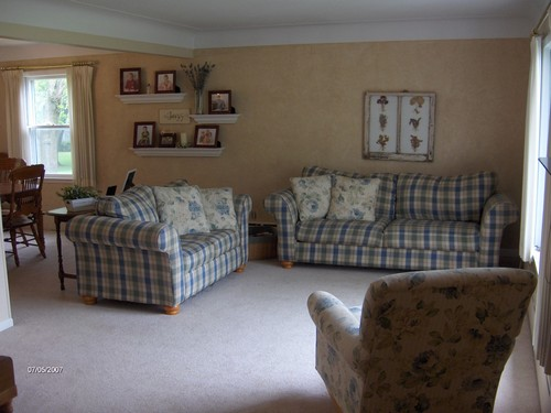 living room. wide open to front yard and to the dining area.  living room has a coved ceiling.