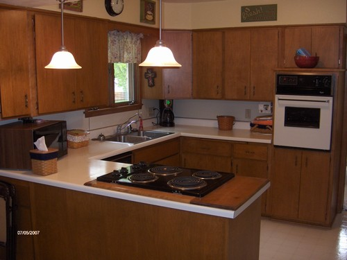 kitchen built in appliances and also an eating area.